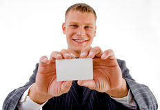 Smiling professional holding business card Royalty Free Stock Image