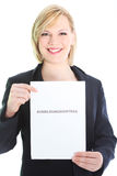 Smiling professional holding sheet of paper Royalty Free Stock Photo