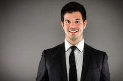 Smiling Professional. Image of a young business professional Stock Photo