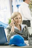 Smiling professional on phone Royalty Free Stock Photo