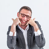 Smiling professional touching his bearded face with satisfaction for kindness. Smiling middle aged male professional touching his bearded face with satisfaction Stock Image