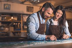 Smiling professionals in the workshop Royalty Free Stock Images