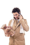 Smiling professor on the phone  in coat with glasses looking art Royalty Free Stock Photography