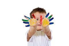 Smiling proud boy with hands full of paint Royalty Free Stock Image