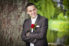 Smiling proud groom - young male in suit Royalty Free Stock Photo