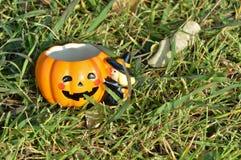 Smiling pumpkin mug for Halloween Stock Photography