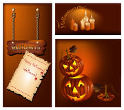 Smiling pumpkins and burning candles. Stock Photography