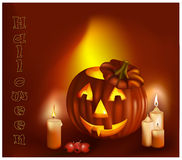 Smiling pumpkins and burning candles. Stock Photos