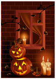 Smiling pumpkins and burning candles. Royalty Free Stock Photos