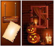 Smiling pumpkins and burning candles. Royalty Free Stock Photography