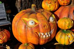 Smiling pumpkins for Halloween. Orange pumpkins heads for Halloween Royalty Free Stock Image