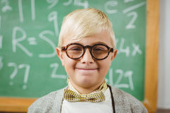 Smiling pupil dressed up as teacher in a classroom Stock Photo