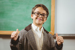 Smiling pupil dressed up as teacher doing thumbs up. Portrait of smiling pupil dressed up as teacher doing thumbs up in a classroom Stock Photos