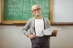 Smiling pupil dressed up as teacher holding books Royalty Free Stock Photo