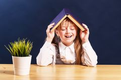 Smiling Pupil Girl with Book stock photos