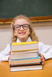 Smiling pupil holding books Royalty Free Stock Photos