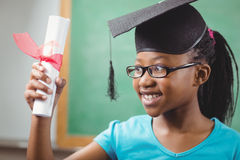 Smiling pupil with mortar board and diploma Royalty Free Stock Image