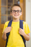 Smiling pupil with schoolbag in a classroom Royalty Free Stock Photography