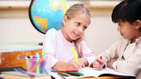 Smiling pupils coloring Royalty Free Stock Photos