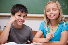 Smiling pupils working together Stock Images