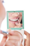 Smiling putting make up Royalty Free Stock Photography