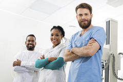 Smiling Radiologists Standing Arms Crossed In Examination Room stock images