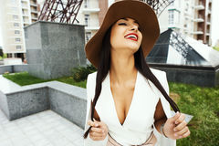Smiling raven haired indian lady posing in backyard of  high-rise building Stock Photography