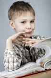 Smiling reader. Little smiling boy with big book royalty free stock photography