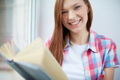 Smiling reader Stock Photo