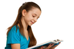 Smiling reading girl. A pretty girl in blue is reading a thick book; isolated on the white background Royalty Free Stock Photography