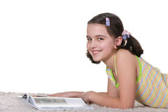 Smiling reading girl Stock Photos