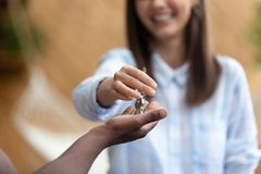 Smiling realtor agent giving keys to apartment buyer close up stock photos