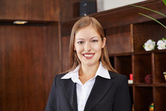 Smiling receptionist at hotel counter Royalty Free Stock Photo