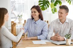 Smiling recruiter handshake female applicant at interview. Smiling recruiter shake hand of female job candidate getting acquainted at interview in office, HR stock image