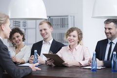 Smiling recruiters during job interview. Group of smiling recruiters during a job interview with a promising candidate Stock Photo