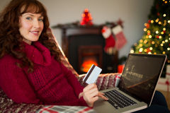 Smiling red hair shopping online with laptop Royalty Free Stock Photography