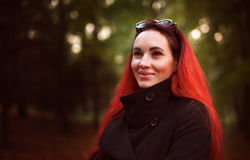 Smiling red hair woman in autumn park Stock Images