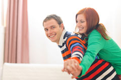 Smiling red hair woman piggybacking boyfriend Royalty Free Stock Photos