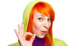 Smiling red hair woman showing ok sign Stock Images