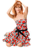 Smiling red-haired girl in a dress Royalty Free Stock Images
