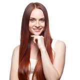 Smiling red haired girl Stock Photography