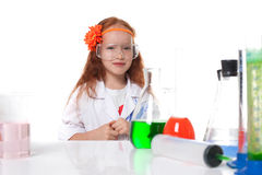 Smiling red-haired schoolgirl posing in lab Royalty Free Stock Photos