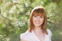 Smiling red-haired woman Stock Image
