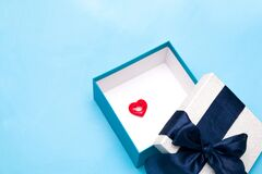 Smiling red heart on a gift box