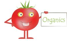 Smiling red tomatoes with green eyes, a white plaque with the inscription Organics Stock Photos
