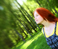 Smiling redhaired girl, outdoors. Portrait of beautiful smiling redhaired girl, outdoors Stock Photos