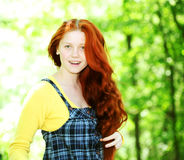 Smiling redhaired girl, outdoors Royalty Free Stock Photos