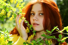 Smiling redhaired girl, outdoors Royalty Free Stock Images