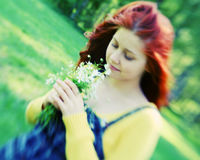 Smiling redhaired girl, outdoors Stock Photos