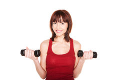 Smiling Redhead With Dumbbells Royalty Free Stock Photography